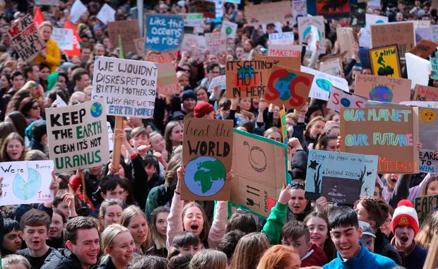Thousands of Dublin students march from St Stephens green to Leinster House today, joining a global protest for action to tackle climate change, which sees public gatherings staged at more than 37 locations across Ireland. Photo: Niall Carson/PA Wire