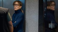 Actress Felicity Huffman is seen inside the Edward R. Roybal Federal Building and U.S. Courthouse in Los Angeles, on March 12, 2019. - (Photo by DAVID MCNEW / AFP)