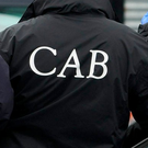 The CAB was aided in the searches by officers from the emergency response unit, the drugs and organised crime bureau, national bureau of criminal investigation, stolen motor vehicles squad and Garda dog unit. Photo: Gareth Chaney / Collins