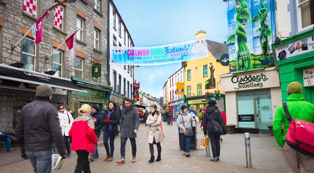 Tourists walking through the streets of Galway