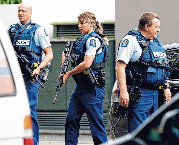 Aftermath: Armed police patrol outside a mosque in central Christchurch, New Zealand. Photo: Mark Baker/AP