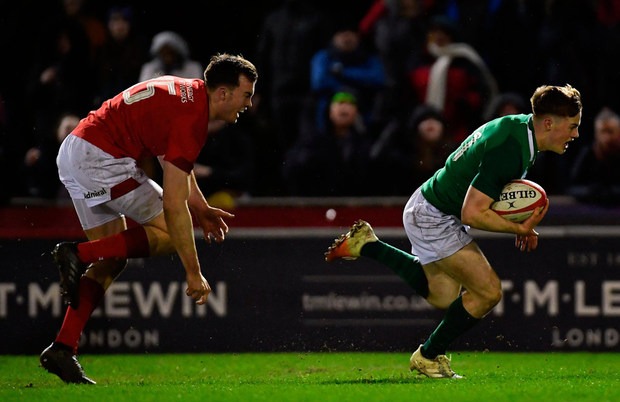 Ireland's Colm Reilly gets past Cai Evans of Wales to score a game winning late second half try. Photo: Piaras Ó Mídheach/Sportsfile