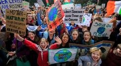 Voice of youth: Pupils from Newpark School, Blackrock, Co Dublin, at a protest at Leinster House to call for action on climate change. Photo: Gareth Chaney