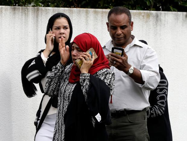 Worried friends and relatives wait outside a mosque in central Christchurch, New Zealand. Photo: Mark Baker/AP