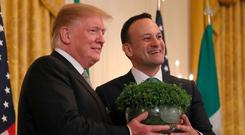 Taoiseach Leo Varadkar presents US President Donald Trump with a bowl of Shamrock during a St Patrick's Day Celebration reception and Shamrock presentation ceremony at the White House. Photo: Brian Lawless/PA