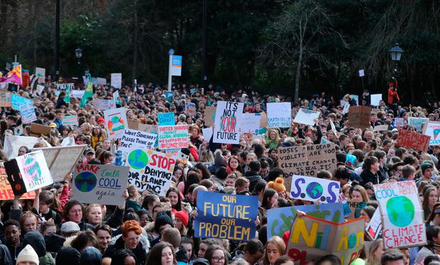 School students from across Ireland rally in Dublin city as they join other youngsters in worldwide protests aimed at persuading political leaders to act now to stop what they see as the growing threat of global climate change. Photo: Niall Carson/PA