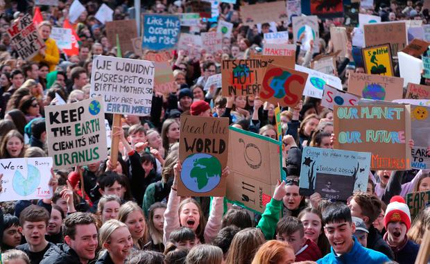 Thousands of Dublin students march from St Stephens green to Leinster House, joining a global protest for action to tackle climate change. Photo: Niall Carson/PA