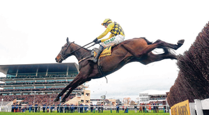 Al Boum Photo, with Paul Townend up, on the way to winning the Cheltenham Gold Cup. Photo: PA