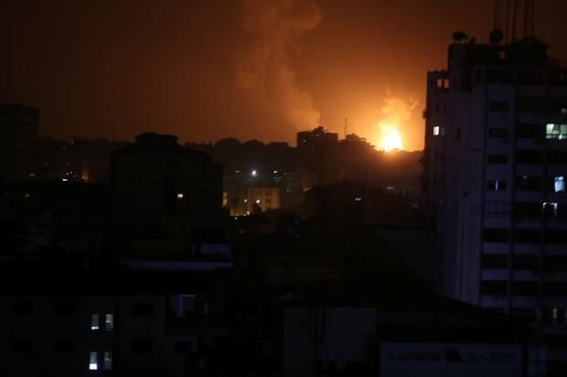 Smoke and flame are seen during an Israeli air strike in Gaza March 15, 2019. Photo: REUTERS/Mohammed Salem