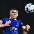 Aaron Drinan of Waterford FC in action against Kevin Toner. Photo: Matt Browne/Sportsfile