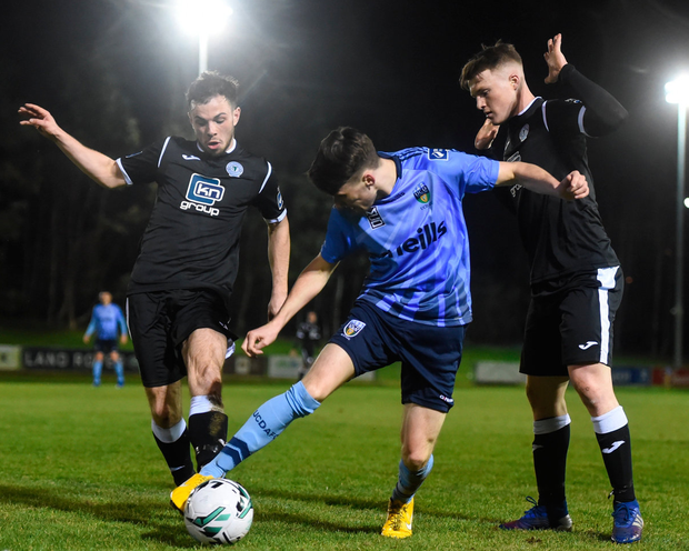 Kevin Coffey of UCD in action against Daniel O'Reilly, right, and Mark Coyle of Finn Harps. Photo by Ben McShane/Sportsfile
