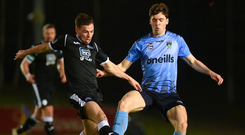 Richie O'Farrell of UCD in action against Mark Coyle of Finn Harps. Photo by Ben McShane/Sportsfile