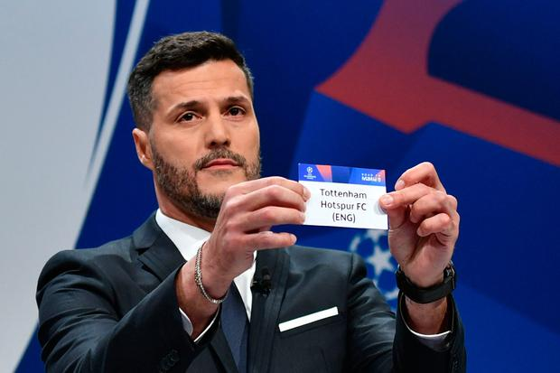 Former Brazilian goalkeeper Julio Cesar shows the name of Tottenham Hotspur football club during the draw for the Champions league quarter-final. Photo: Fabrice COFFRINI / AFP