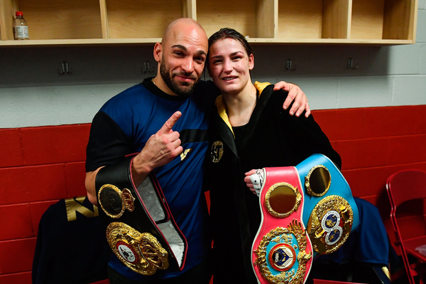 Katie Taylor celebrates in her dressing room with her coach Ross Enamait