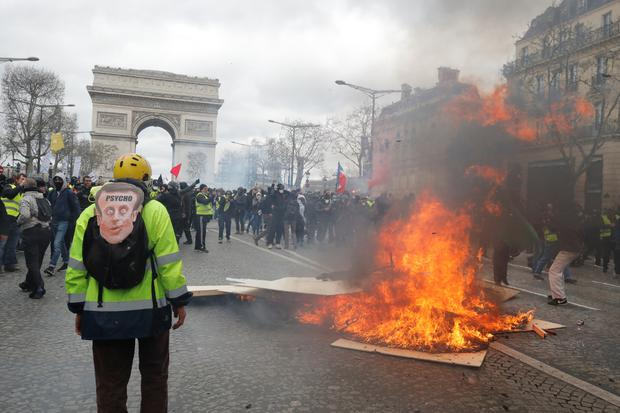 Protesters clash with French riot police during a demonstration by the