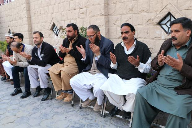 People and relatives pray as they condole with Nadeem Rasheed, brother of Naeem Rashid who along with his son was killed in Christchurch mosque attack in New Zealand, at family home in Abbottabad, Pakistan, March 16, 2019. REUTERS/Stringer