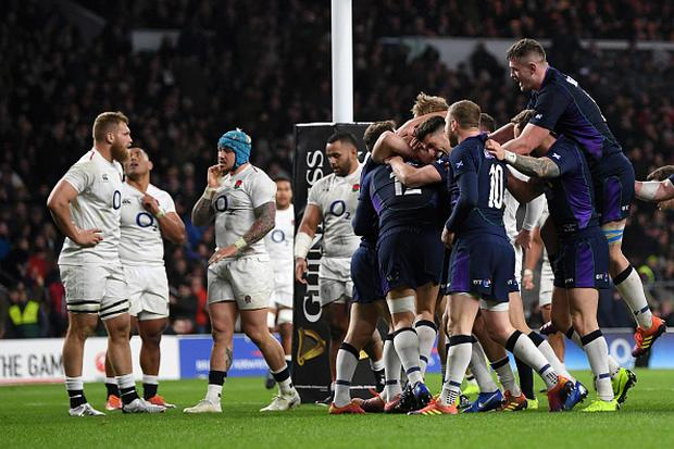 LONDON, ENGLAND - MARCH 16: Sam Johnson of Scotland celebrates with team mates as he scores their sixth try during the Guinness Six Nations match between England and Scotland at Twickenham Stadium. (Photo by Shaun Botterill/Getty Images)
