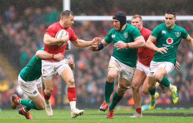 Wales' Gareth Davies (left) and Ireland's Jason Stockdale in action. Photo: David Davies/PA Wire