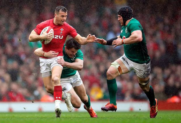 Wales' Gareth Davies tries to fend off the Ireland team. Photo: Adam Davy/PA Wire