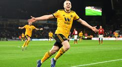 WOLVERHAMPTON, ENGLAND - MARCH 16: Diogo Jota of Wolverhampton Wanderers (R) celebrates after scoring his team's second goal during the FA Cup Quarter Final match between Wolverhampton Wanderers and Manchester United at Molineux on March 16, 2019. (Photo by Michael Regan/Getty Images)