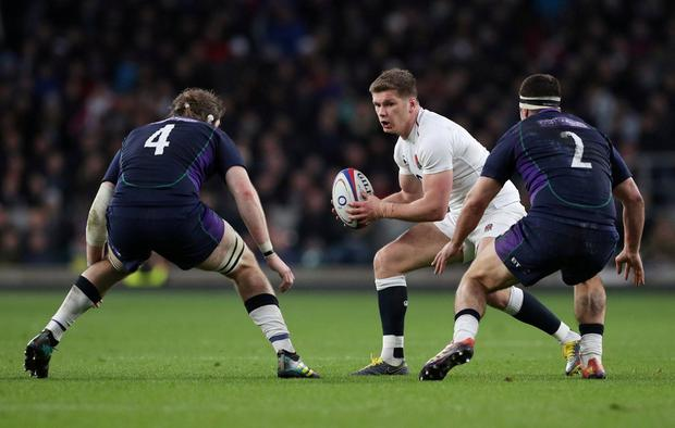 England's Owen Farrell in action with Scotland's Ben Toolis and Stuart McInally. Photo: Hannah McKay/Reuters