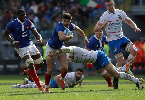 Italy's Sergio Parisse, right, tackles France's Romain Ntamack, center and Yacouba Camara, left. Photo: Alessandra Tarantino/AP Photo