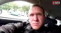 HORRIFIC: This frame from the video that was live-streamed last Friday shows a gunman, who used the name Brenton Tarrant on social media, in a car before the mosque shootings in New Zealand. Picture: AP