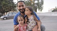 A LUCKY FAMILY: Waseem Daraghmeh and his two daughters, who all survived