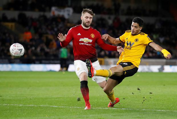 Manchester United's Luke Shaw in action with Wolves' Raul Jimenez. Photo: Reuters