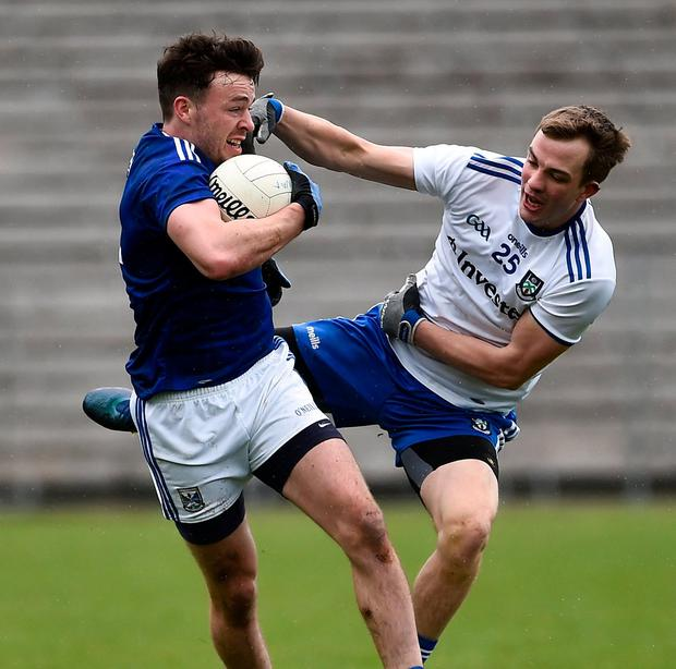 Conor Moynagh of Cavan in action against Jack McCarron of Monaghan. Photo: Oliver McVeigh/Sportsfile
