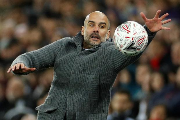 Manchester City manager Pep Guardiola with the match ball. Photo: Reuters