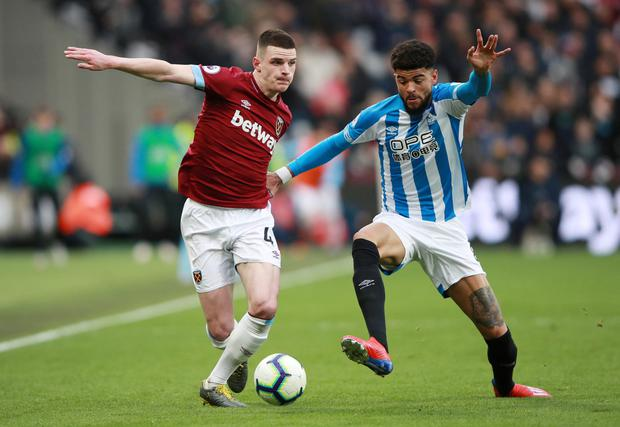 Huddersfield Town's Philip Billing in action with West Ham's Declan Rice. Photo: Reuters