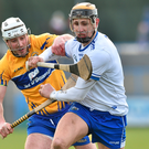 Clare's Patrick O'Connor challenges Waterford's Maurice Shanahan. Photo: Sportsfile
