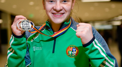 Boxer Amy Broadhurst is guaranteed at least bronze at the European Women's Championship in Madrid, Spain.