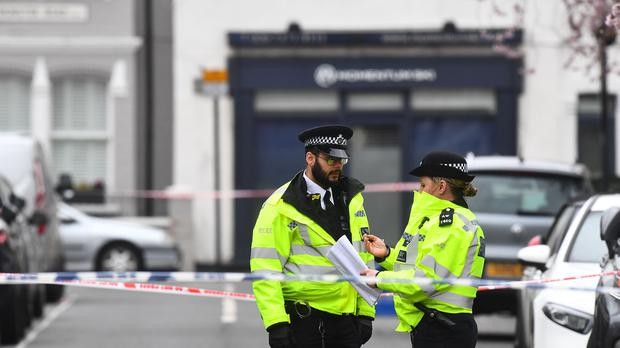 Police at the scene in Fulham, west London, where a 29-year-old man was stabbed to death this morning (Victoria Jones/PA)