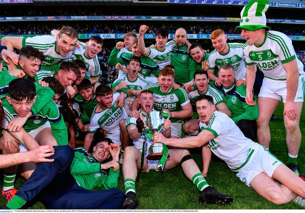 Ballyhale Shamrocks players celebrate with the cup