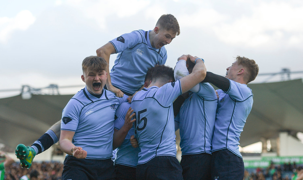 St Michael's College players celebrate their side's fourth try scored by Robert Gilsenan