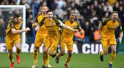LONDON, ENGLAND - MARCH 17: Brighton celebrate victory after the penalty shoot out during the FA Cup Quarter Final match against Millwall at The Den on March 17, 2019 in London, England. (Photo by Mike Hewitt/Getty Images)