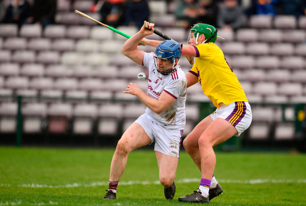 Conor McDonald of Wexford in action against Paul Killeen of Galway. Photo by Sam Barnes/Sportsfile