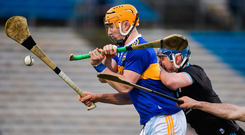 Tipp toppled: Tipperary's Mark Kehoe is challenged by Dublin's Paddy Smyth during their quarter-final clash in Thurles. Photo by Daire Brennan/Sportsfile
