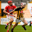 Aidan Nolan of Kilkenny in action against Bill Cooper and Robert Downey of Cork. Photo by Harry Murphy/Sportsfile