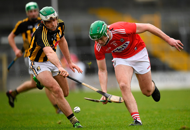 Robbie O'Flynn of Cork in action against Paddy Deegan of Kilkenny. Photo by Harry Murphy/Sportsfile