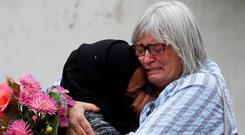 Women embrace near Masjid Al Noor mosque in Christchurch, New Zealand, March 17, 2019. REUTERS/Jorge Silva