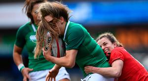 Ireland's wing Beibhinn Parsons is tackled by Wales's Jasmine Joyce during yesterday's Six Nations clash at Cardiff Arms Park. Photo by Stu Forster/Getty Images