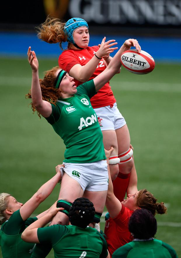 Wales player Gwen Crabb (r) and Aoife McDermott compete for a lineout ball. Photo by Stu Forster/Getty Images