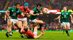 Ireland's Jacob Stockdale, supported by Bundee Aki, is tackled by Wales' Aled Davies in Cardiff on Saturday. Photo by Ramsey Cardy/Sportsfile