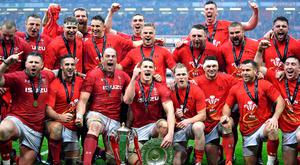 Wales celebrate their Grand Slam and Six Nations success after their comprehensive victory over Ireland on Saturday. Photo by Dan Mullan/Getty Images