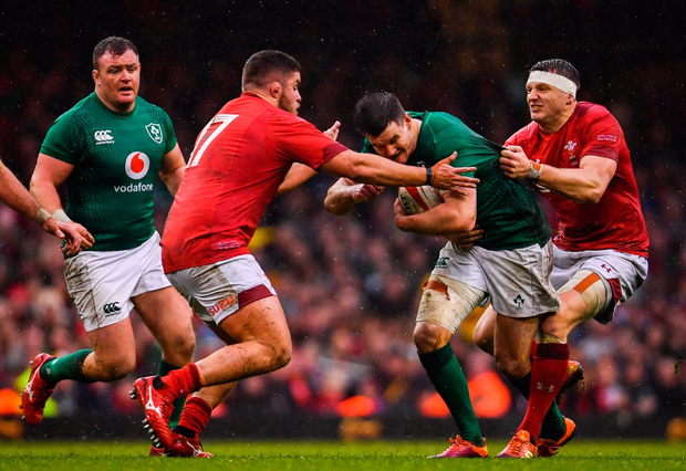 Jonathan Sexton of Ireland is tackled by Nicky Smith, left, and Hadleigh Parkes of Wales. Photo by Ramsey Cardy/Sportsfile