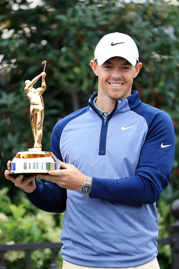 PONTE VEDRA BEACH, FLORIDA - MARCH 17: Rory McIlroy of Northern Ireland celebrates with the trophy after winning The Players Championship on The Stadium Course at TPC Sawgrass on March 17, 2019 in Ponte Vedra Beach, Florida. (Photo by Sam Greenwood/Getty Images)