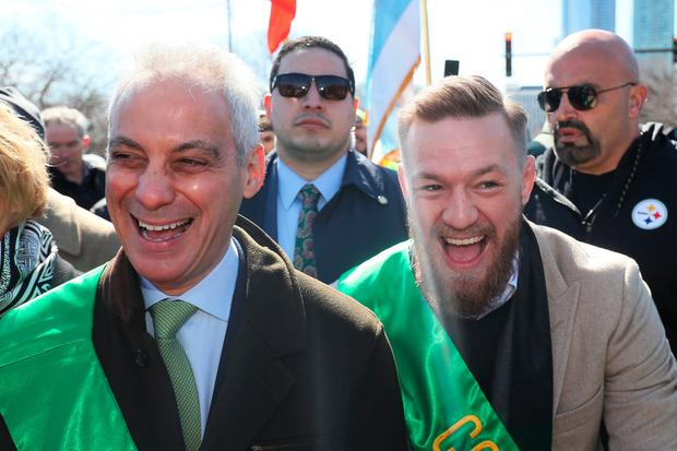 Appearance: Conor McGregor joins Mayor of Chicago Rahm Emanuel (left) during the parade in Chicago. Photo: Brian Lawless/PA Wire
